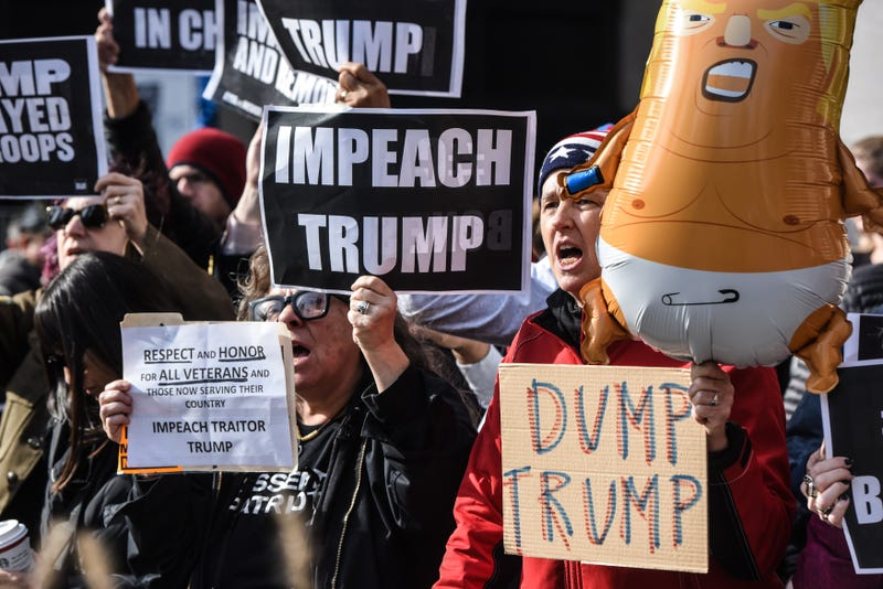 People participate in a protest against U.S. President Donald Trump on Veterans Day on November 11, 2019 in New York City.