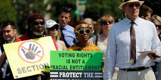 Supporters of the Voting Rights Act listen to speakers outside the Supreme Court. (Win McNamee/Getty Images)