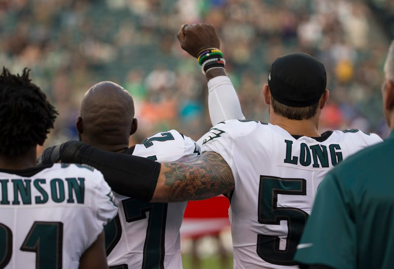 Malcolm Jenkins, No. 27 of the Philadelphia Eagles, holds his fist in the air while Chris Long, No. 56 of the Philadelphia Eagles, puts his arm around him during the national anthem prior to the preseason game against the Buffalo Bills at Lincoln Financial Field on Aug. 17, 2017, in Philadelphia. (Mitchell Leff/Getty Images)