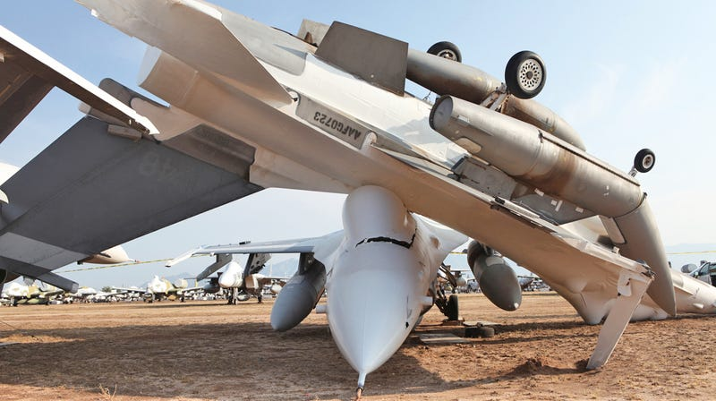 Illustration for article titled Massive Storm Tosses Jets At Air Force Boneyard Around Like Toys