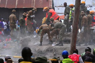 Rescue workers remove debris from the rubble of the six-story building that collapsed, killing 23 people, in Nairobi, Kenya's suburb of Huruma on May 3, 2016.SIMON MAINA/AFP/Getty Images