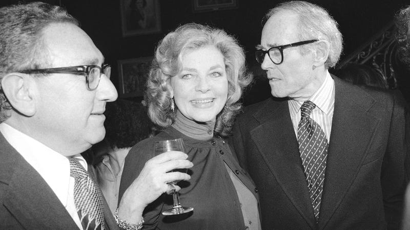 "Bacall at her 1979 book party for ""By Myself,"" with a pair of Henrys—Kissinger and Fonda. (Photo via AP Images.)"
