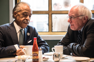 The Rev. Al Sharpton and Democratic presidential candidate Bernie Sanders have breakfast Feb. 10, 2016, at Sylvia's in Harlem.CBS New York Screenshot