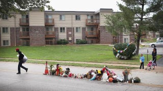 On Sept. 11, 2014, in Ferguson, Mo., more than a month after the shooting of teenager Michael Brown, a memorial remains in the middle of the road where he died after being shot by Officer Darren Wilson.Scott Olson/Getty Images