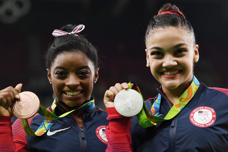 Balance beam bronze medalist Simone Biles and silver medalist Lauren Hernandez of the United States pose for photographs after the medal ceremony for that event at the Rio de Janeiro Olympics on Aug. 15, 2016. Laurence Griffiths/Getty Images