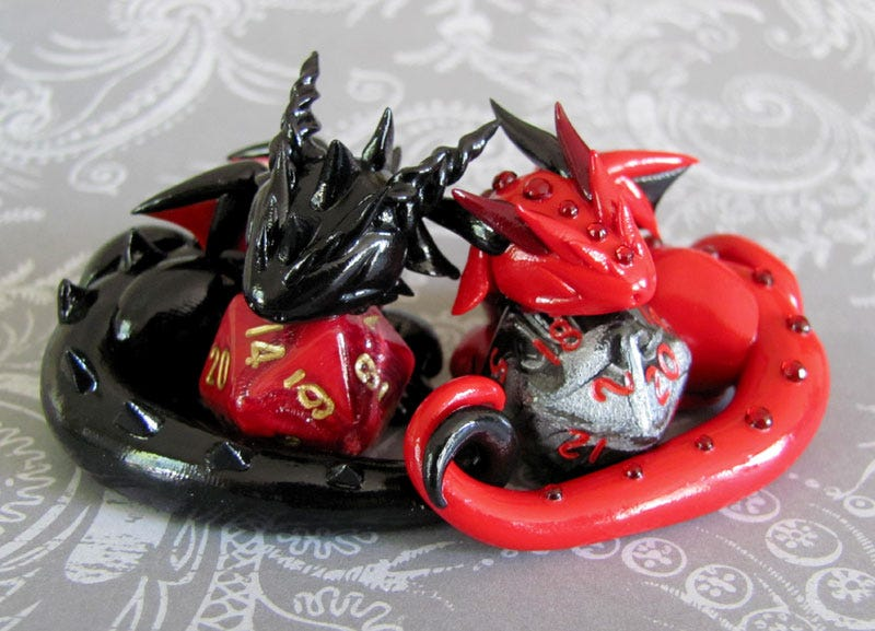 Illustration for article titled Adorable sculpted dragons guard your 20-sided dice