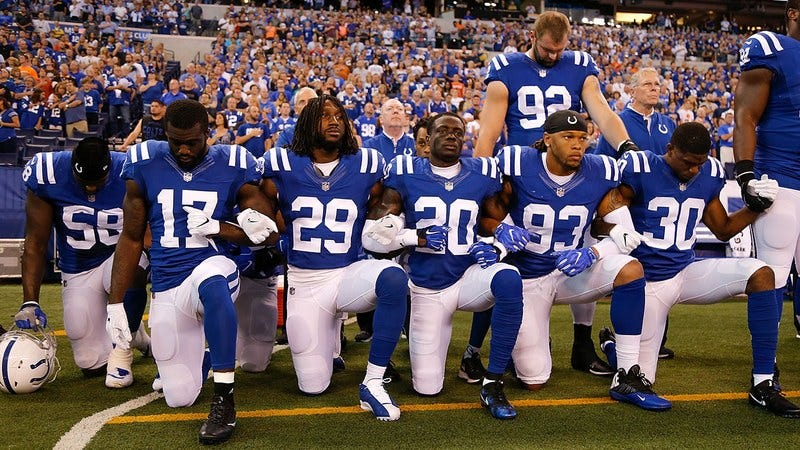 NFL football players kneeling during the national anthem.