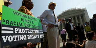 Supporters of the Voting Rights Act listen to speakers discuss the Supreme Court ruling. (Win McNamee/Getty Images)