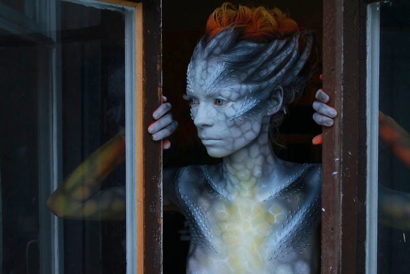 Illustration for article titled Impressive body painting transforms women into aliens [NSFW]