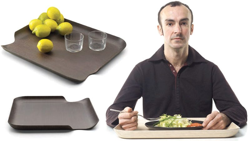 Illustration for article titled The Clever Cutouts On These Serving Trays Promise To Make Cafeteria Dining Less Terrible