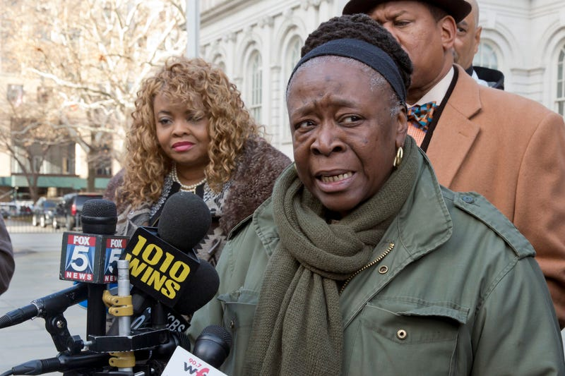 Plaintiffs Annette Richardson (left) and Stephanie Thomas, of New York City's Fire Department, speak during a news conference on the steps of  City Hall on Dec. 6, 2017, in New York City. (Richard Drew/AP Images)