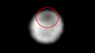 """Illustration for article titled There's a Dark """"Anti-Polar Cap"""" on Pluto's Moon Charon"""