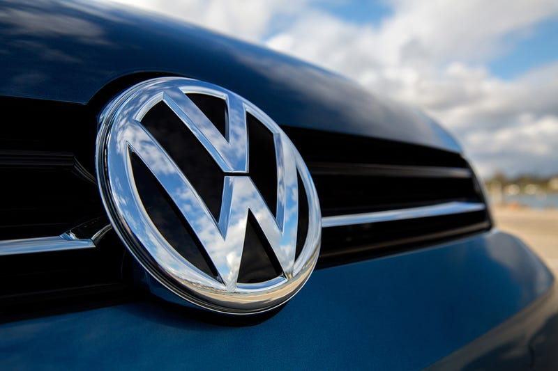 """Here, a Volkswagen TDI sits beneath a vibrant blue sky as the owner (not pictured) sings along to Kool & The Gang's """"Celebration"""" in response to today's Dieselgate settlement announcement."""