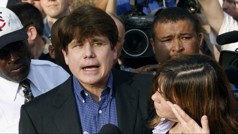 Blagojevich in 2012 next to wife Patti. Photo via AP.