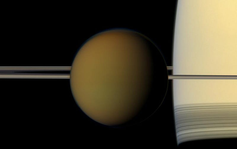 Saturn's largest moon, Titan, passing in front of the gas giant's rings in a glorious shot captured by Cassini. Image: NASA