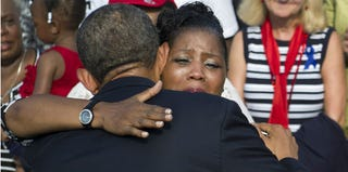President Obama comforts a woman during a remembrance ceremony in Arlington, Va. (pool/Getty Images)