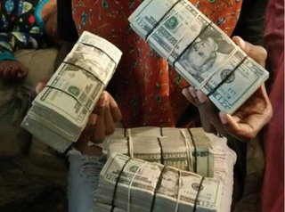 Tony Harris posted to his Facebook page Oct. 5, 2015, a photo of his wife holding stacks of cash. A week later, Harris was dead. Twitter