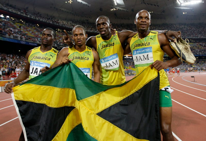 L-R: Nesta Carter, Michael Frater, Usain Bolt, and Asafa Powell. Photo by David J. Phillip/AP Images