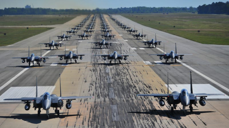 Illustration for article titled This Is What 70 Fully Armed F-15s Taxying On A Single Runway Look Like