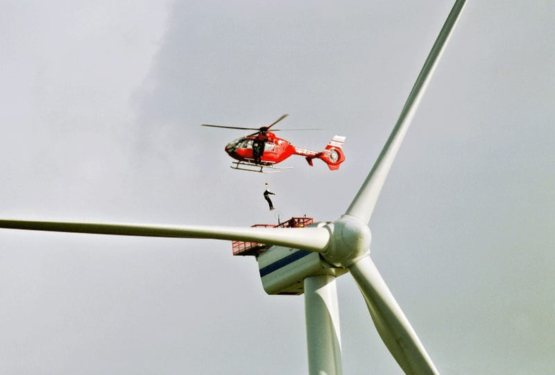 Illustration for article titled Helicopters Used to Fix Giant Wind Turbines
