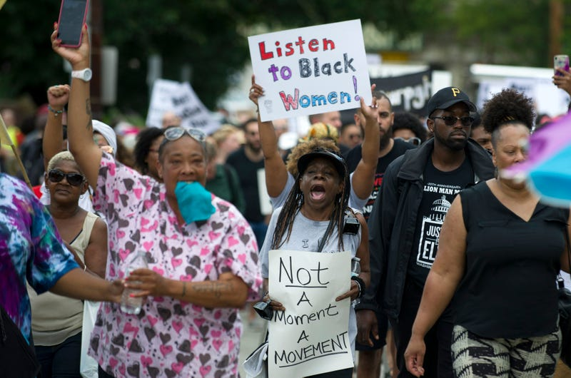 Marchers walk through the Homewood neighborhood during their Black Brilliance Collective: March and Gathering on Aug. 19, 2017, in Pittsburgh.