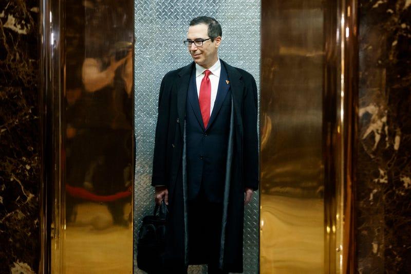 Photo of a Goldman Sachs guy ascending a golden elevator: AP