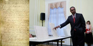 Emancipation Proclamation (AFP/Getty); Reginald Washington of National Archives (Alex Wong/Getty)