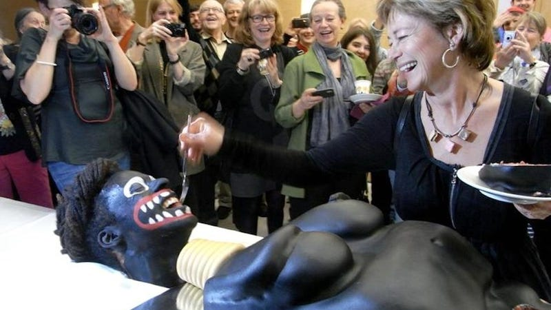 Illustration for article titled Swedish Official Gleefully Cuts Racist Black Lady Cake, Delights Onlookers