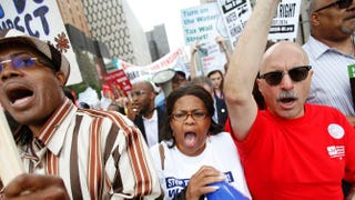 Demonstrators in Detroit July 18, 2014, protest the Detroit Water and Sewerage Department's decision to deny water to those delinquent with their bills. Now residents of nearby Flint, Mich., are dealing with contaminated water.Joshua Lott/Getty Images
