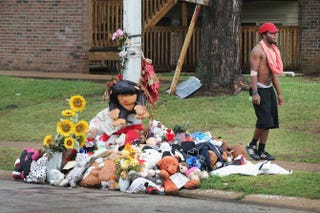 A rain-soaked memorial on Sept. 10, 2014, at the location in Ferguson, Mo., where teenager Michael Brown was shot and killed by police Officer Darren Wilson in August.Scott Olson/Getty Images
