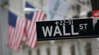 Street signage for Wall Street outside the New York Stock Exchange Sept. 16, 2013John Moore/Getty Images
