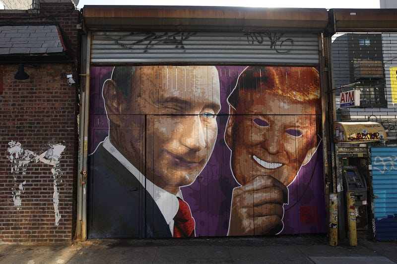 A mural depicting a winking Vladimir Putin taking off his Donald Trump mask is painted on a storefront outside a bar called Levee in Brooklyn, N.Y., on Feb. 25, 2017.  (Spencer Platt/Getty Images)