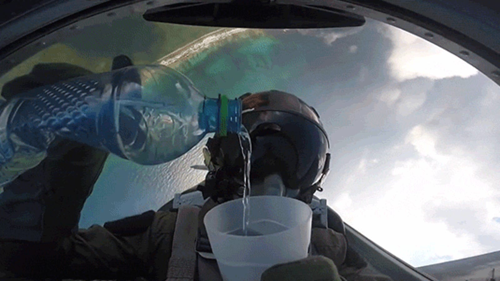 Cool View of a Pilot Pouring Water Upside Down While Doing a Barrel Roll in a Fighter Jet