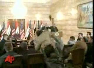 Illustration for article titled Video: President Bush Ducks Shoe Attack