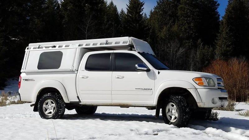Illustration for article titled At $14,500, Could This 2004 Toyota Tundra TRD Camper Have You Saying Get Outta Town?