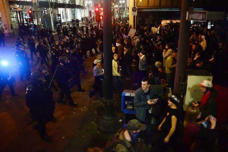 Police wearing riot gear watch as demonstrators protest against Donald Trump's presidential-election victory at City Hall in Portland, Ore., on Nov. 11, 2016.ANKUR DHOLAKIA/AFP/Getty Images