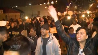 Protesters march in Phoenix, calling for justice in the fatal shooting of Rumain Brisbon, 34. Brisbon was shot after an altercation with a Phoenix police officer. NBC News Screenshot