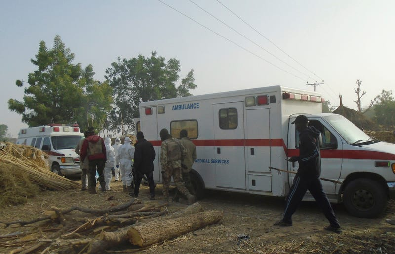 Emergency workers and security forces at the site of a suicide-bomb attack at the outskirts of Maiduguri, Nigeria, on Feb. 17, 2017.  (Jossy Ola/AP Images)