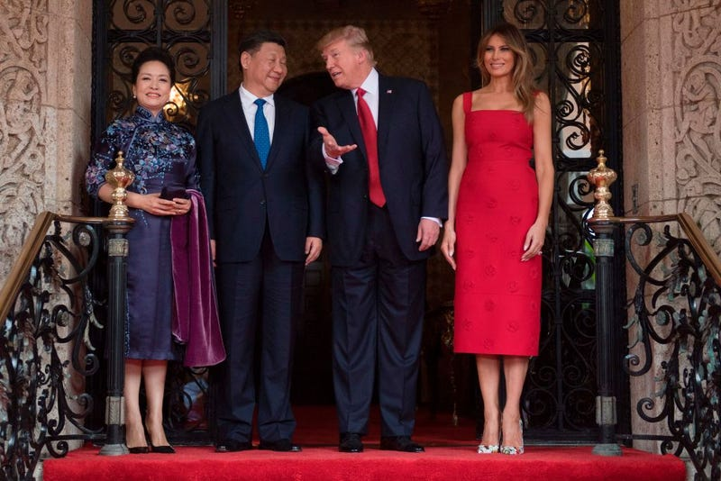First lady Melania Trump (right) and President Donald Trump (second from right) pose with Chinese President Xi Jinping and his wife Peng Liyuan at Trump's Mar-a-Lago estate in West Palm Beach, Fla., on April 6, 2017. (Jim Watson/AFP/Getty Images)