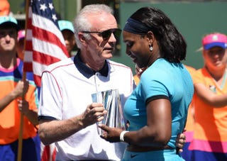 Indian Wells Tennis Garden CEO Raymond Moore presents the second-place trophy to Serena Williams after the women's final of the BNP Paribas Open at the Indian Wells Tennis Garden in Indian Wells, Calif., on March 20, 2016. Victoria Azarenka defeated Williams 6-4, 6-4.ROBYN BECK/AFP/Getty Images