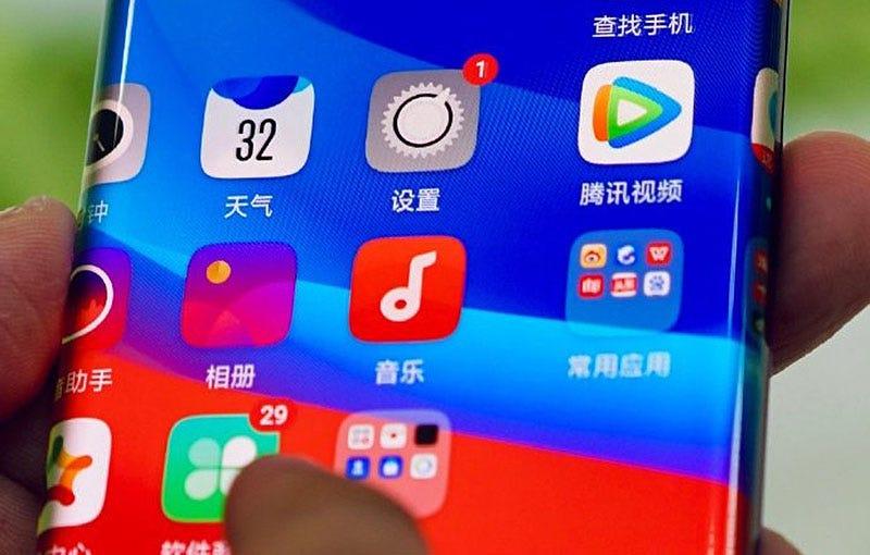 Illustration for article titled Oppo Waterfall Screen: una pantalla para móvil tan extrema que elimina los botones físicos de los laterales