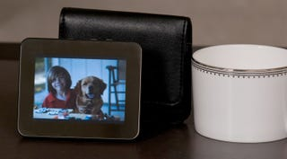 Illustration for article titled HP Portable Digital Picture Frame Lets You Take Your Pics on the Go