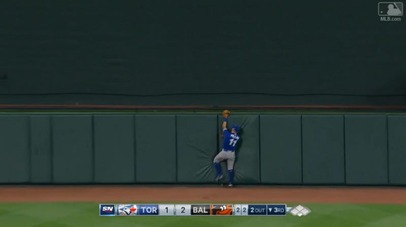 Illustration for article titled Kevin Pillar Robs Manny Machado, Eats Fence