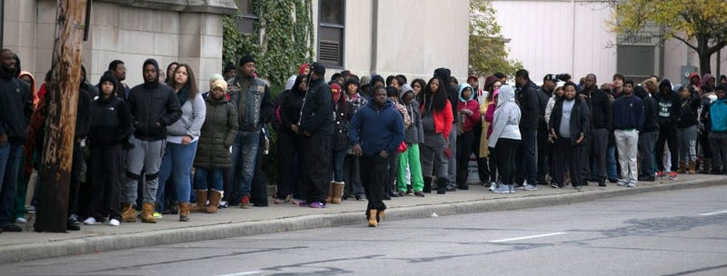Hundreds of people lined up on East 30th Street in Cleveland, leading to the Hillary Clinton campaign offices, the morning of Oct. 28, 2016, to get free tickets to a Jay Z concert to be held Nov. 4, 2016. David Petkiewicz/Cleveland.com