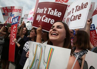 People cheer in front of the U.S. Supreme Court after ruling was announced on the Affordable Care Act June 25, 2015, in Washington, D.C. The court ruled that the Affordable Care Act may provide nationwide tax subsidies to help poor and middle-class people buy health insurance.Mark Wilson/Getty Images