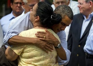 President Obama tours the aftermath of Hurricane Irene. (Getty)