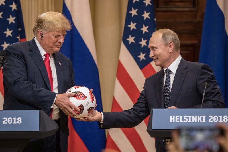 Russian President Vladimir Putin, right, hands U.S. President Donald Trump a World Cup football during a joint press conference after their summit on July 16, 2018 in Helsinki, Finland.
