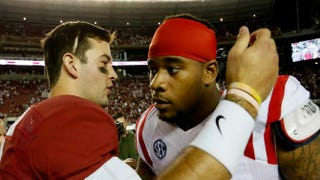 After a September 2013 game in Tuscaloosa, Ala., A.J. McCarron of the Alabama Crimson Tide hugs Robert Nkemdiche of the Mississippi Rebels after Alabama's 25-0 win.Kevin C. Cox/Getty Images