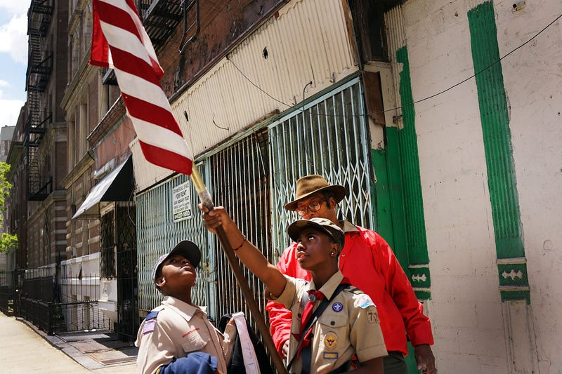 Boy Scouts prepare to march with soldiers, veterans and various other military aligned groups in the 369th Infantry Regiment Parade in Harlem on May 18, 2014, in New York City. (Spencer Platt/Getty Images)
