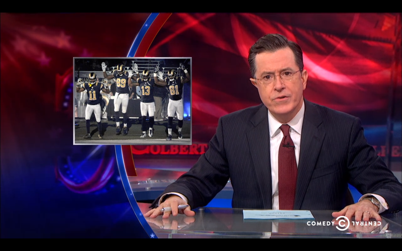 """Illustration for article titled Colbert Lampoons Reaction To The Rams' """"Hands Up, Don't Shoot"""" Intro"""